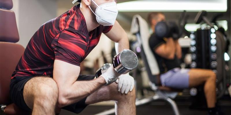Men working out with gloves and a mask