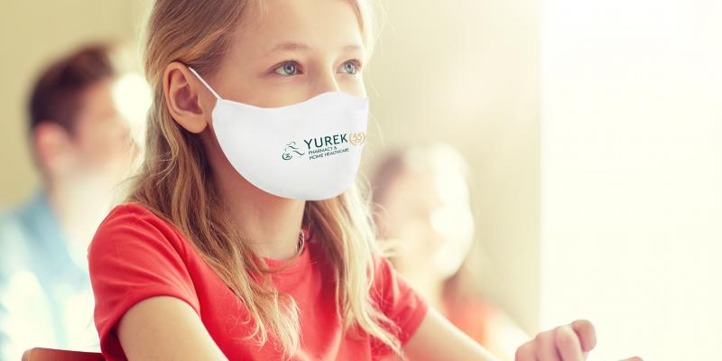 Young student wearing white mask