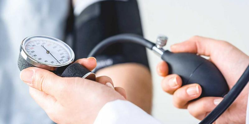 women using the blood pressure cuff on an arm