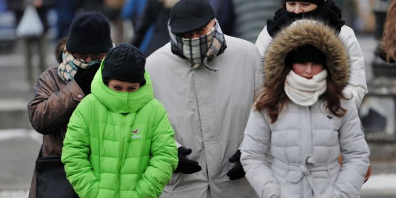 family of four walking all bundle up in warm clothes